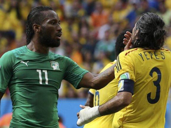 <p> Selbst Superstar Didier Drogba (l) wurde bei der 1:2-Niederlage seiner Elfenbeinküste gegen Kolumbien etwas ungemütlich, Leidtragender war dann Mario Yepes. Foto:&nbsp;Mauricio Duenas<br /> 19.06.2014 (dpa)</p>