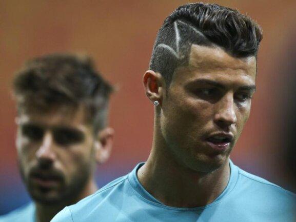 <p> Portugal muss bei der WM endlich auf Zack kommen, die passende Frisur hat Cristiano Ronaldo bereits. Foto:&nbsp;Jose Sena Goulao<br /> 22.06.2014 (dpa)</p>