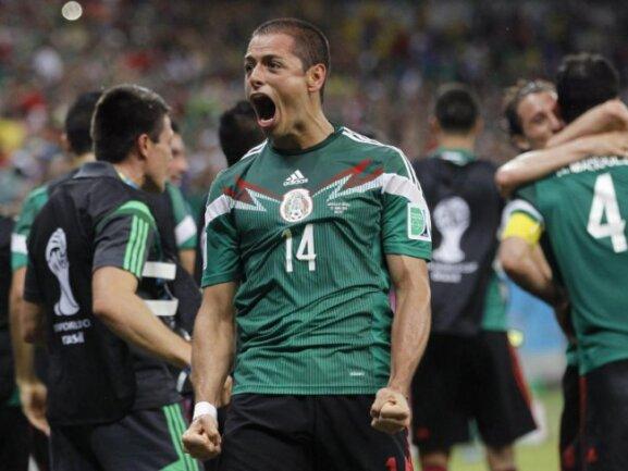<p> Gut gebrüllt! Javier «Chicharito» Hernandez feiert mit seinen Mexikanern den Einzug ins Achtelfinale. Foto: Chema Moya<br /> 24.06.2014 (dpa)</p>