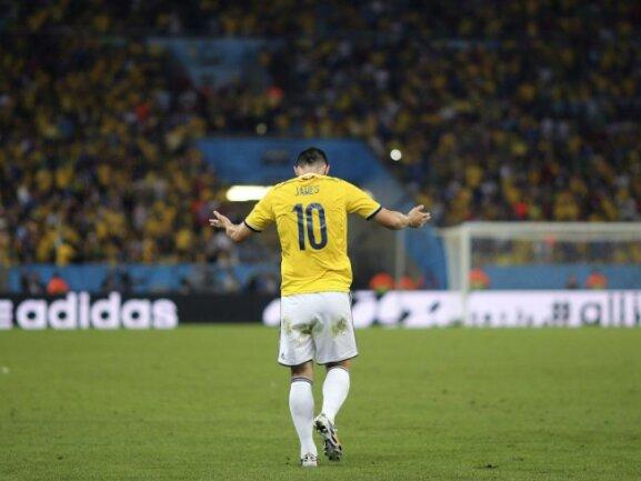 <b>Artig</b><br/>Kolumbiens Torschütze James Rodriguez verbeugt sich nach seinem Treffer zum 1:0. Foto: Antonio Lacerda<br/>28.06.2014 (dpa)