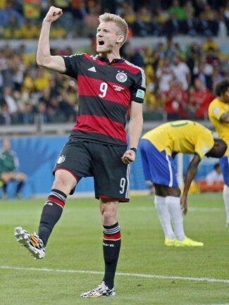 <b>Der Hammer</b><br/>André Schürrle feiert sein Tor zum 6:0 für Deutschland, und auch das 7:0 geht auf sein Konto. Foto: Dennis Sabangan<br/>08.07.2014 (dpa)