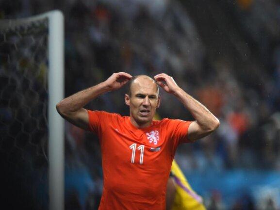 <b>Zum Haare raufen</b><br/>Wenn da welche wären: Arjen Robben ärgert sich über eine vergebene Chance. Foto:Marius Becker<br/>10.07.2014 (dpa)