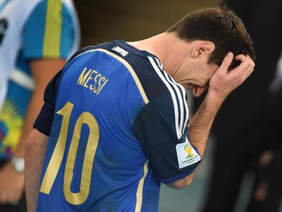<b>Untröstlich</b><br/>Argentiniens Weltstar Lionel Messi war nach dem verlorenen Finale untröstlich. Foto: Andreas Gebert<br/>14.07.2014 (dpa)