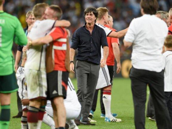 <b>Glücklich</b><br/>Bundestrainer Joachim Löw wollte mit dem Strahlen gar nicht mehr aufhören. Foto: Andreas Gebert<br/>14.07.2014 (dpa)