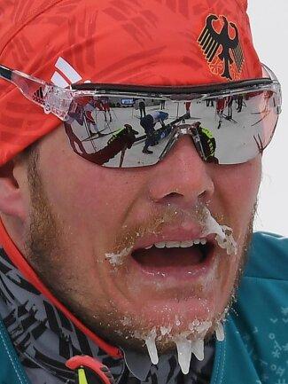 <b>Frostig</b><br/>Beim Skiathlon fror Lucas Bögl eine Barterweiterung aus Eiszapfen. Foto: Hendrik Schmidt<br/>11.02.2018 (dpa)