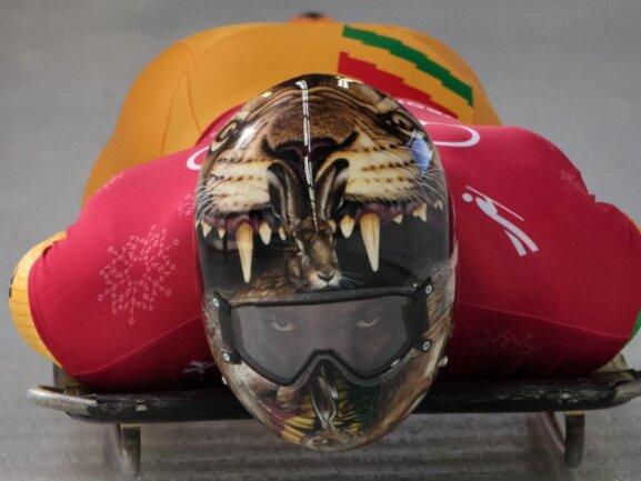<b>Bissig</b><br/>Skeletonpilot Akwasi Frimpong aus Ghana zeigte sich schon im Training angriffslustig. Foto: Joel Marklund/Bildbyran via ZUMA Press<br/>12.02.2018 (dpa)