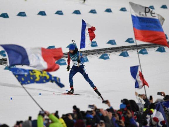 <b>Tricolore</b><br/>Im Sprint patzte Martin Fourcade noch, bei der Verfolgung war er wieder voll da: Der französische Biathlet holte sich den Olympiasieg. Foto: Hendrik Schmidt<br/>12.02.2018 (dpa)