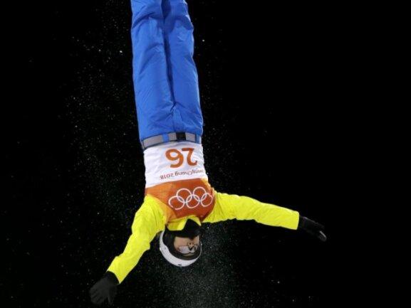 <b>Kopf über</b><br/>Akrobatik im Bokwang Phoenix Snow Park: AkmarzhanKalmurzayeva aus Kazachstan in Aktion. Foto: Lee Jin-Man/AP<br/>15.02.2018 (dpa)