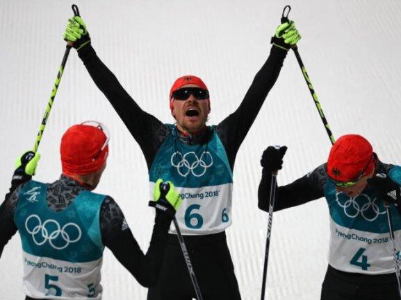 <b>Dreifach-Triumph</b><br/>Gold, Silber und Bronze: Den deutschen Kombinierern gelingt der Dreifach-Triumph in Pyeongchang. Foto: Daniel Karmann<br/>20.02.2018 (dpa)