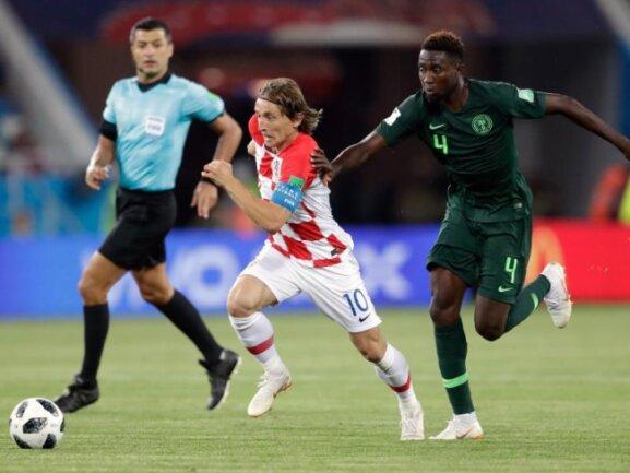 <b>Führungsspieler</b><br/>Luka Modric (M) ist nicht nur Herz des kroatischen Mittelfeldes, sondern erzielte auch das wichtige 2:0. Foto: Petr David Josek/AP<br/>16.06.2018 (dpa)