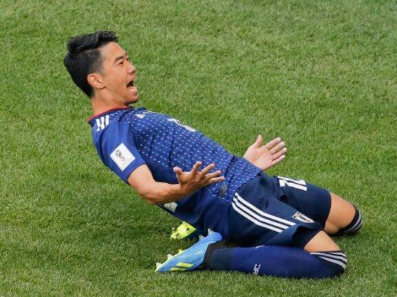 <b>Japan-Star</b><br/>Japans Star Shinji Kagawa jubelt über sein verwandelten Elfmeter gegen Kolumbien. Am Ende siegten die Japaner mit 2:1. Foto: Vadim Ghirda/AP<br/>19.06.2018 (dpa)