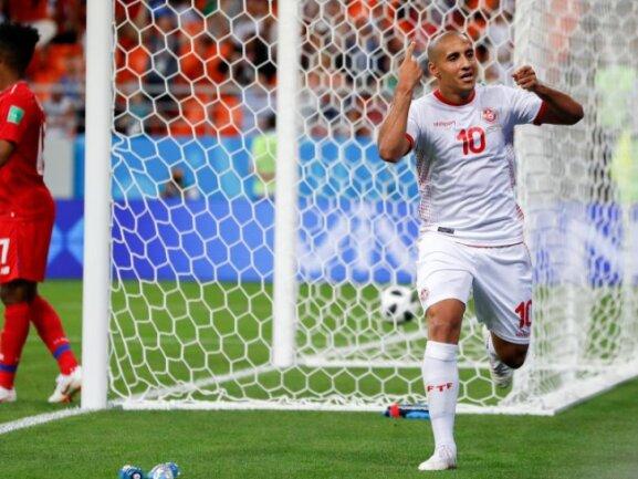<b>Historisch</b><br/>Wahbi Khazri (r) feiert das 2:1 gegen Panama. Es war der erste WM-Sieg Tunesiens seit 40 Jahren. Foto: Darko Bandic/AP<br/>28.06.2018 (dpa)
