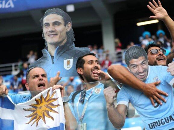 <b>Tribünengast</b><br/>Edinson Cavani fehlt im Viertelfinale gegen Frankreich verletzungsbedingt. Für die Fans von Uruguay findet er dennoch Platz - zumindest in Plakatform auf der Tribüne. Foto: Christian Charisius<br/>06.07.2018 (dpa)