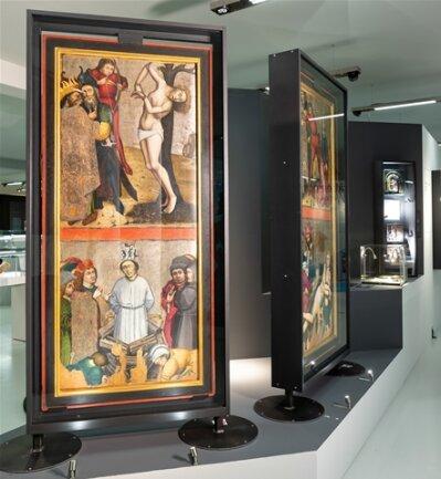 <p>Dieser Altarflügel aus Roudník aus der Zeit von 1470 bis 1480zeigt die älteste erhaltene Darstellung von Jan Hus als Märtyrer (unterer Bereich). Seine Anhänger und Nachfolger verehren ihn gemeinsam mit frühchristlichen Heiligen.</p>