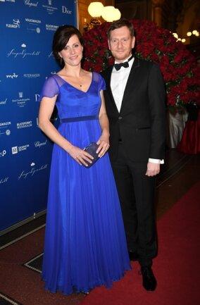 <p>Der Ministerpräsident des Freistaates Sachsen Michael Kretschmer (CDU) und seine Lebensgefährtin Annett Hofmann</p>