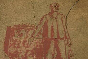 Das begehrte Wandbild: Bergmann mit Kohlenhunt.