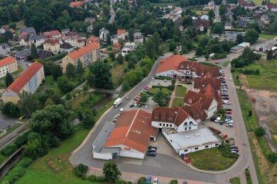 Blick auf das Einkaufszentrum Anger in Neukirchen aus der Vogelperspektive. Dort gibt es einige leerstehendeLaden- und Gewerbeflächen. Die Rathauschefin möchte, dass sich das ändert.