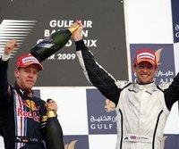 Sebastian Vettel (l.) jubelt mit Sieger Jenson Button