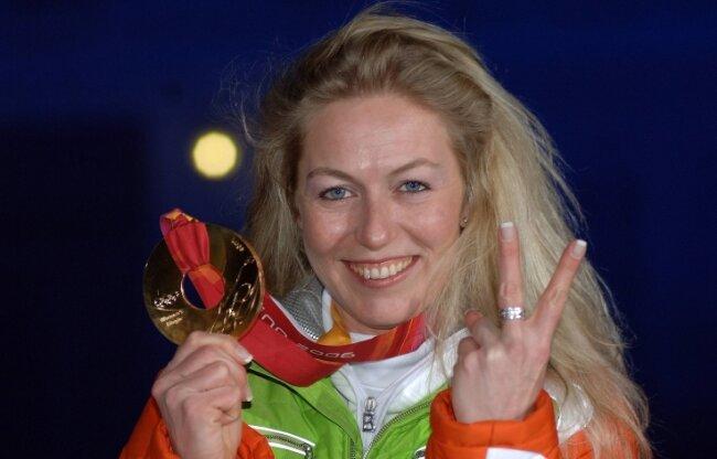 Sylke Otto freut sich über ihren zweiten Olympiasieg - 2006 bei den Olympischen Spielen auf der Bahn in Cesana.