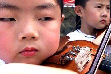 Chinesische Kinder sind besonders musikalisch.