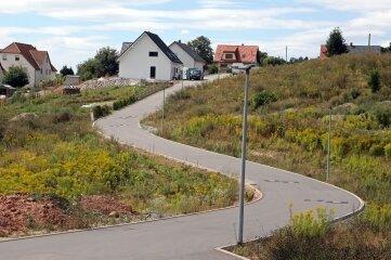 Die neue Straße ist fertig. Am St.-Anna-Weg, benannt nach einer Schutzheiligen der Bergleute, sollen Eigenheime entstehen.