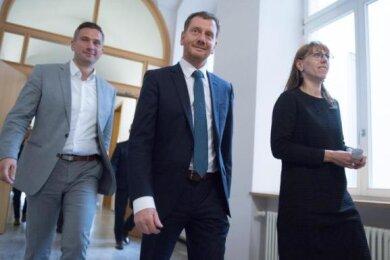 Sachsens SPD-Chef Martin Dulig (l.), Ministerpräsident Michael Kretschmer und Katja Meier, die Verhandlungsführerin der Grünen.