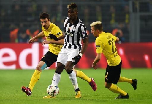Pogba (Mitte) muss gegen Dortmund verletzt vom Feld