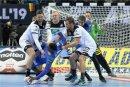 Hendrik Pekeler, Patrick Wiencek und Fabian Böhm (v. l.) stoppen Frankreichs Rückraumass Dika Mem. DIe Abwehr ist das Prunkstück der deutschen Mannschaft.