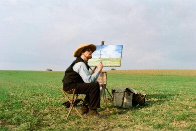 Vincent Van Gogh (Willem Dafoe) beim Malen.