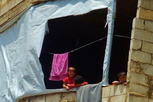 17 Familien hausen in den oberen drei Etagen ihres Hauses in Baabda.