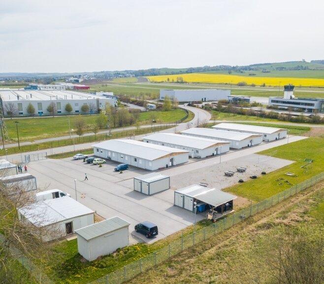 Wegen des Containerdorfs in Jahnsdorf gibt es zwischen Gemeinde und dem Landkreis Erzgebirge Streit.