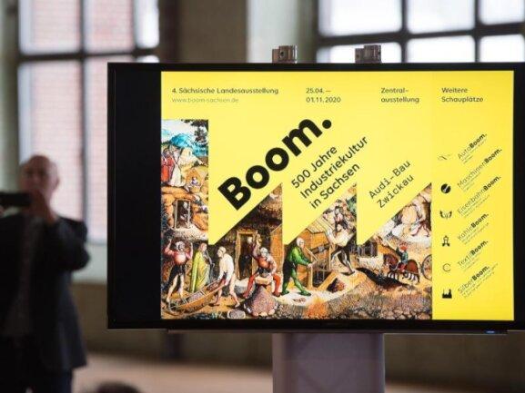 Ein Ausstellungsplakat für die 4. Sächsische Landesausstellung 2020 wird auf einem Fernsehbildschirm gezeigt.