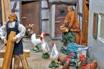 Miniaturfiguren am Bauernhof gehören ebenso dazu wie ...