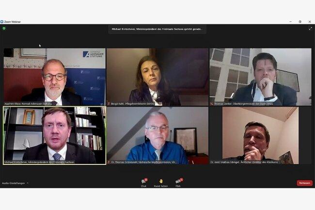 Zoom-Konferenz statt Schlagabtausch am Gartenzaun: Diesmal hatte Michael Kretschmer (unten links) Experten an seiner Seite.