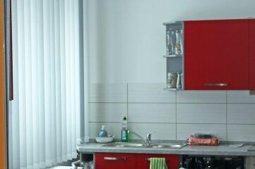 Eine moderne Kücheneinrichtung gehört zur Neuausstattung dazu.