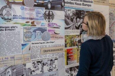 Auch Auerbach findet sich in der Ausstellung wieder. Im unteren Teil des Bildes geht es um den Geldumtausch am 1. Juli 1990 in der Stadt.