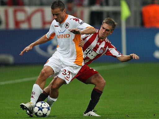 Viel Mühe mit dem AS Rom: Philipp Lahm (r.) und der FC Bayern