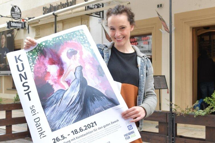 """Tonja Arina Gold, Schauspielerin, Produktionsassistentin und Hobbymalerin, stellt ihr Bild """"Durch die Nacht"""" (Acryl auf Leinwand, 30 mal 40 Zentimeter) als Poster im Schaufenster der Stadtwirtschaft Freiberg aus. In der Aktion """"Kunst sei Dank!"""" soll es für einen guten Zweck versteigert werden."""