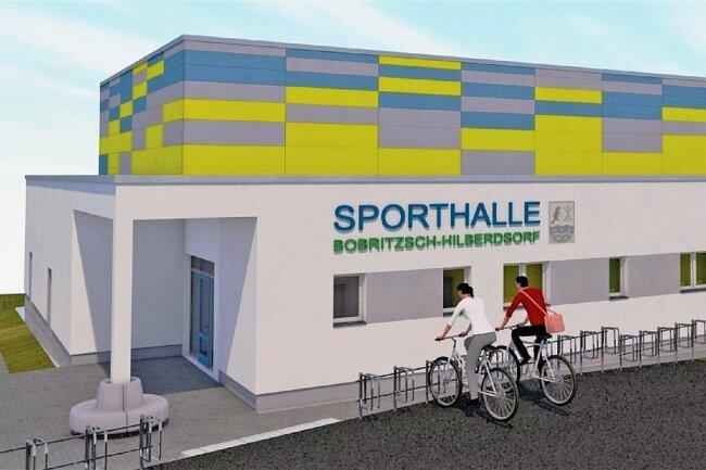 Die Visualisierung zeigt, wie die neue Sporthalle in Niederbobritzsch einmal aussehen soll. Der Grundstein ist gelegt. Wenn alles reibungslos läuft, kann die Halle zum Beginn des Schuljahres 2022/23 für Schul- wie Vereinssport zur Verfügung stehen.