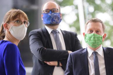 Katja Meier (Bündnis90/Die Grünen, l-r), Justizministerin von Sachsen, Christian Piwarz (CDU), Kultusminister von Sachsen, und Michael Kretschmer (CDU), Ministerpräsident von Sachsen.