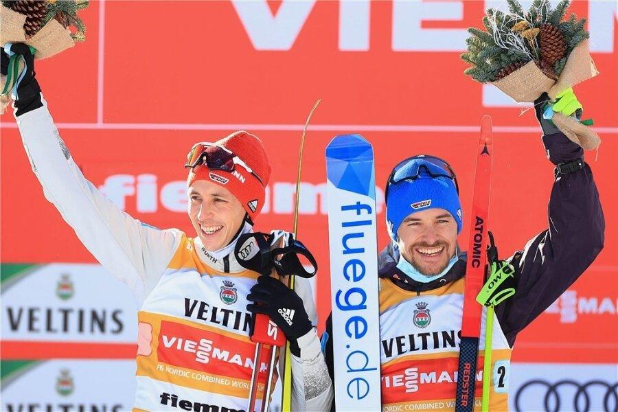 Eric Frenzel (links) und Fabian Rießle jubeln nach dem Teamsprint.