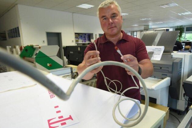 Nichts ging mehr in der Online-Druckerei: Die Leitungen in der Firma von Heiko Schmalfuß konnten für etwa einen Monat keine Daten übertragen. Der Wechsel von Vodafone zur Telekom hatte sich verzögert.