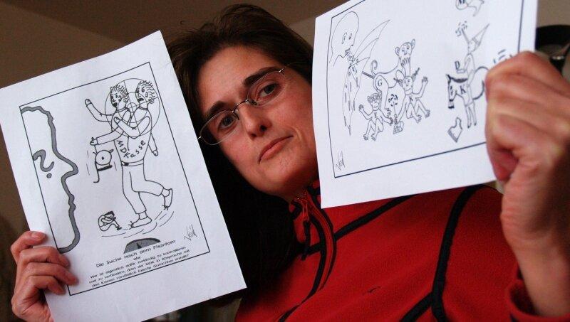 """<p class=""""artikelinhalt"""">Karikaturen mit Fragezeichen: Diana Voigt will wissen, wer wie den MDK kontrolliert.</p>"""