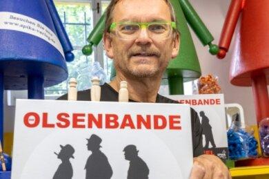 Statt der typischen Spika-Spitzhüte symbolisieren die Spielfiguren im Olsenbande-Spiel ihre Vorbilder. Die Idee dazu haben Ralf Viehweg und ein Berliner Spieleautor entwickelt. Es wird im Oktober erscheinen.