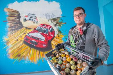 Graffitikünstler Benjamin Knoblauch hat im vergangenen Jahr ein Wandbild für den AWO-Hort im Förderzentrum am Bergbaumuseum Oelsnitz gespendet.