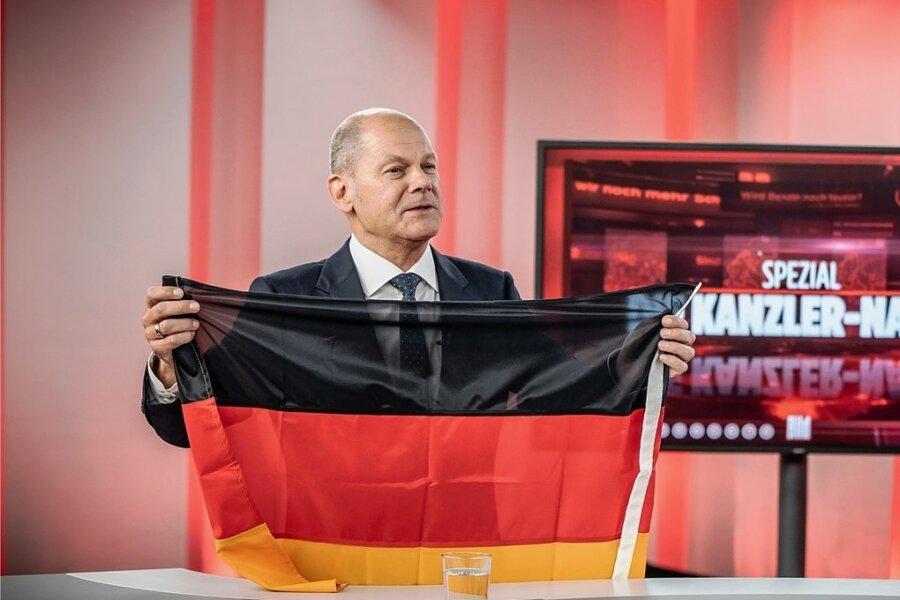 Olaf Scholz (SPD) sollte sich zu seinen Gefühlen beim Anblick der Deutschland-Fahne erklären.