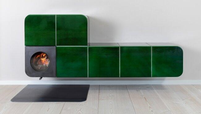 """Der Ofen schwebt scheinbar im Raum: Für dieses besondere Exemplar wurde der Plauener Axel Götze mit dem """"Oskar der Ofenwelt"""" ausgezeichnet."""