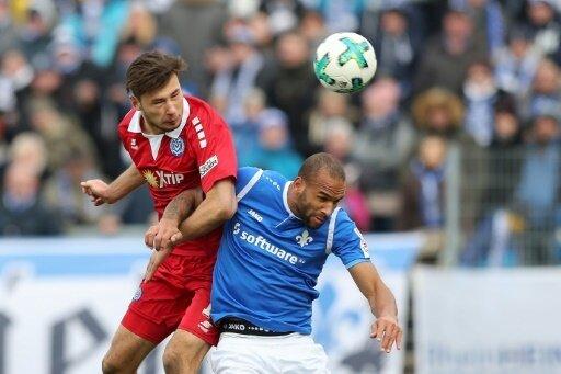Boyd (r.) wird auch nächste Saison in Darmstadt spielen