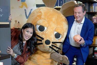 Buntes deutsches Fernsehen: Wissenschaftsjournalistin Mai Thi Nguyen-Kim, die Maus und Medizin-Kabarettist und Moderator Eckart von Hirschhausen.