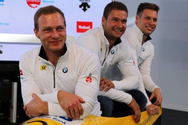Drei Männer, ein Ziel - Olympiamedaillen in Korea: Francesco Friedrich, Johannes Lochner und Nico Walther (von links).